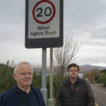 Fort William resident, Chris Jones (left) with Councillor Andrew Baxter at the non-working warning lights beside Lundavra Primary School last week. Photograph: Iain Ferguson, alba.photos NO F45 Lundavra Lights 01