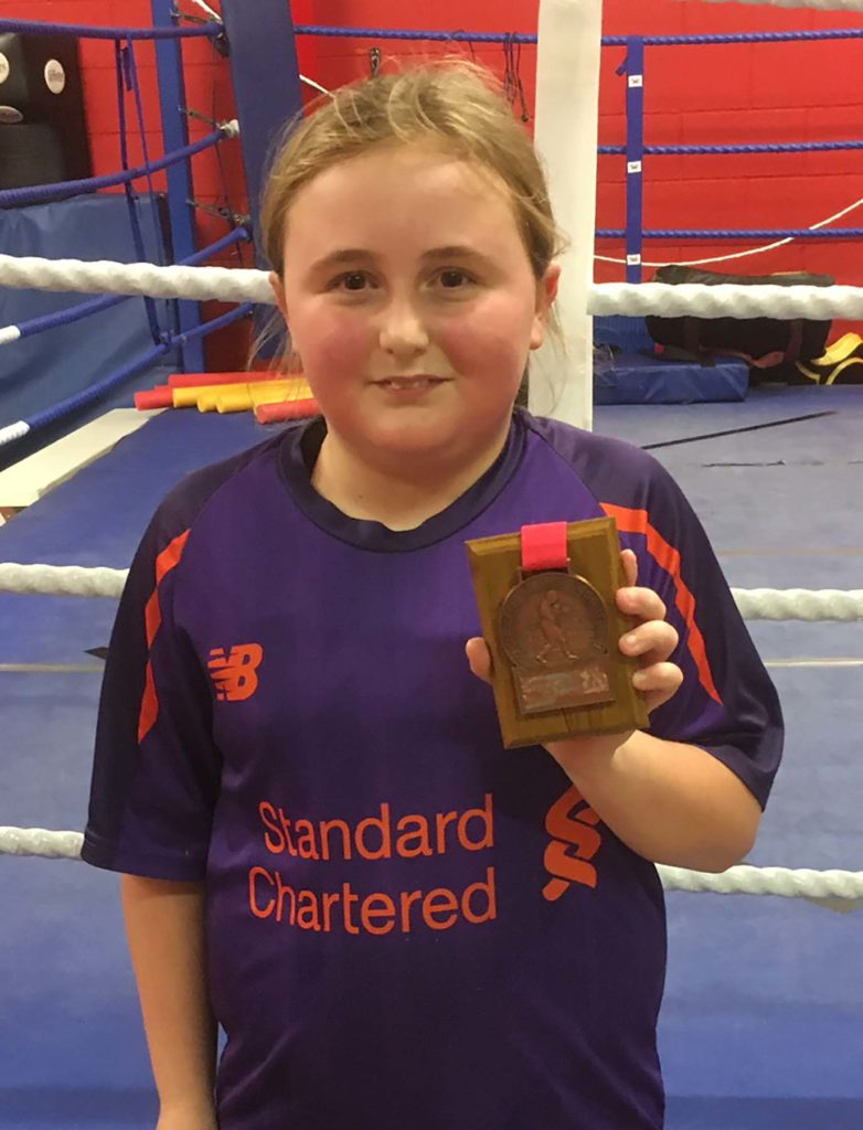 Keira Welsh proudly shows of her medal. NO-F46-KEIRA-BOXING-MEDAL.jpg