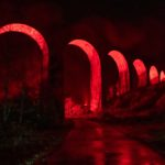 Glenfinnan Viaduct lit up with red light to mark Armistice Day. Photograph: Abrightside Photography. NO F47 Glenfinnan Viaduct - lit up red-4