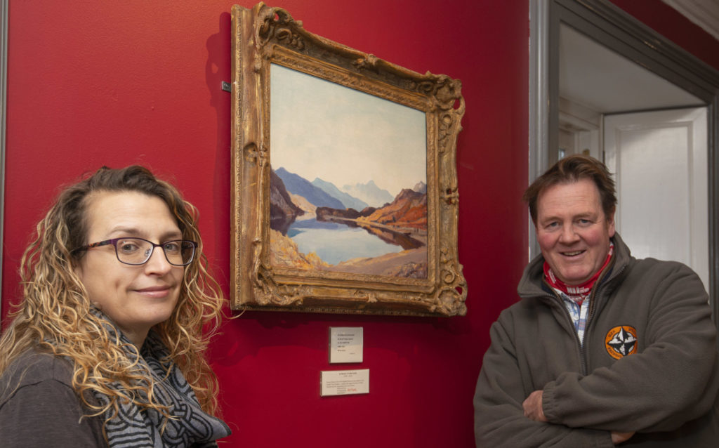 West Highland Museum curator Vanessa Martin, with museum chair, Ian Peter MacDonald, and the newly acquired painting. Photograph: Iain Ferguson, alba.photos NO F47 Museum painting 01