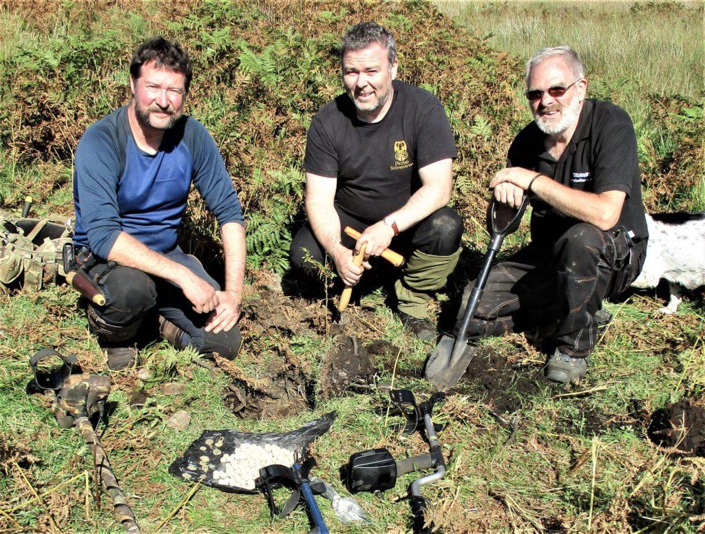 Paul Macdonald, Gary Burton and David McGovern made the discovery near Lochailort in September. NO F47 jacobite hoard 02