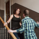 Domestic Abuse - The Reality. Photograph: Laura Dodsworth. NO-F49-CC-on-stairs-scaled.jpg