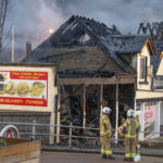 Firefighters examine the wrecked remains of the Pier Head takeaway, adjoining barber shop and beauty salon in Fort William's West End on Monday. Photograph: Iain Ferguson, The Write Image. NO-F50-FORT-WILLIAM-FIRE-04-scaled.jpg