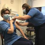 Lynsey Mackenzie receives her Covid-19 vaccination from Occupational Health Nurse, Marion Campbell. NO F51 Lynsey Mackenzie Community Staff Nurse
