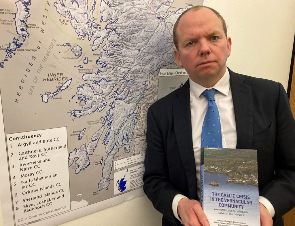 MSP Donald Cameron with a copy of the University of the Highlands and Islands' long-awaited report on Gaelic: 'The Gaelic Crisis in the Vernacular Community'. NO F53 Donald Cameron with Gaelic Report 2 (2)