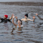 Dean Cameron (Santa hat) and some of his supporters spend four minutes 'soaking in' the cold to raise awareness of an money for mental health charities. Photograph: Iain Ferguson, The Write Image. NO F53 Loch Linnhe Swim 02
