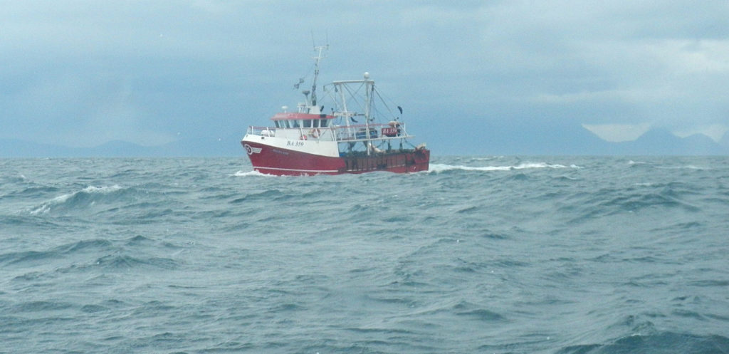 A fishing boat works the waters off the island of Eigg. Picture: Iain Ferguson. FISHING-BOAT-OFF-EIGG_iain-ferguson.jpg