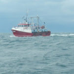 A fishing boat works the waters off the island of Eigg. Picture: Iain Ferguson. FISHING-BOAT-OFF-EIGG_iain-ferguson.jpg