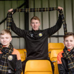 Fort FC first team captain John Treasurer shows off the new tartan with junior team members Lewis Luxton, left, and Jack Stephen . Photograph: Johnpaul Peebles, Abrightside Photography. NO F04 Mon the Fort Tartan LT
