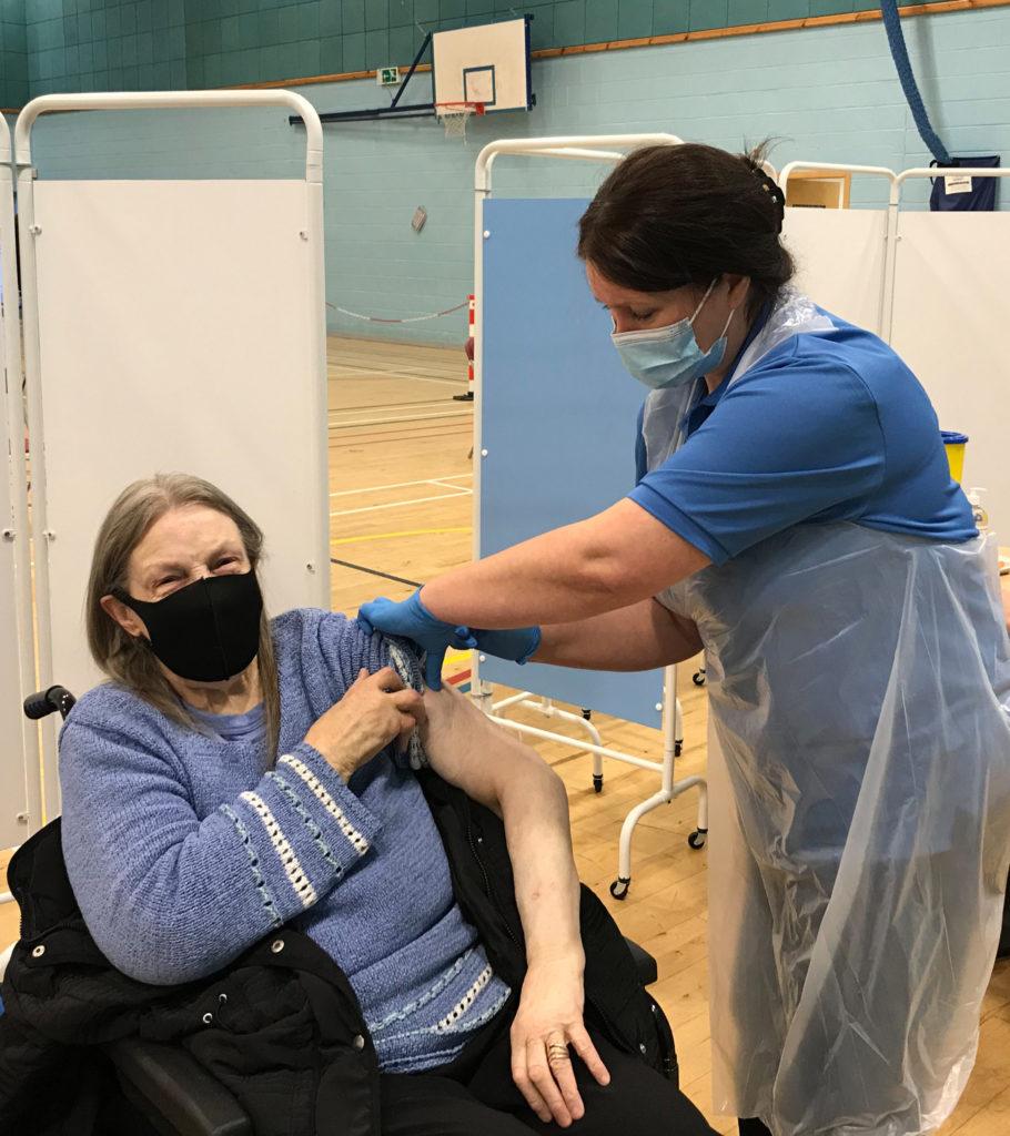 Ishbel MacAulay receiving her vaccination from NHS Western Isles Occupational Health Nurse Janet Miskovic. NO F05 Vaccination - Ishbel MacAulay and OH Nurse Janet Miskovic