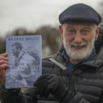 Veteran climber and Lochaber Mountain Rescue Team member, George Bruce, with his newly published book of his life and times in the hills over many decades. Photograph: Iain Ferguson, The Write Image. NO F08 George Bruce book 03