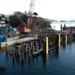 East view of pier demolition: concrete deck removal, temporary walkway to shore bollard and platform for crew access gangway are both operational. NO F08 Harris pier 01