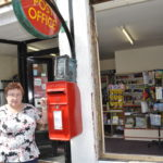 Lorna MacLennan outside Taynuilt Post Office as the new windows go in 17_T24_taynuiltnewwindows_postoffice
