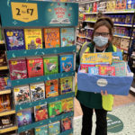 Emma Macinnes, Community Champion at Morrisons Fort William, with a selection of books for children. NO F10 Morrisons world book day