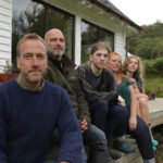 Presenter Ben Fogle and the Goddard family outside their home near Strontian during filming last summer. NO-F13-Ben-Fogle-New-Lives-In-The-Wild-Se-14-Ep-6-18-scaled.jpg
