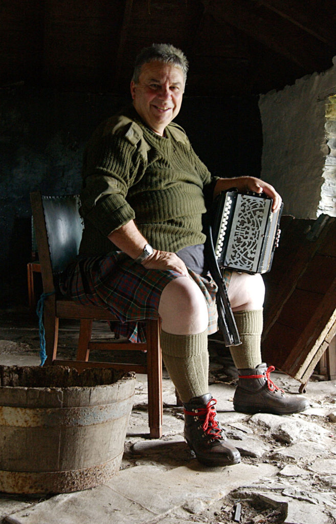 Musician Fergie MacDonald in the blackhouse beside his home at Mingarry. Photograph: Iain Ferguson, alba.photos NO F02 Fergie Macdonald 04