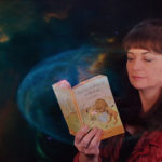 Mary Ann Kennedy with a copy of CS Lewis' The Lion, The Witch and The Wardrobe. NO F14 MAK Narnia Radio Promo Cosmic
