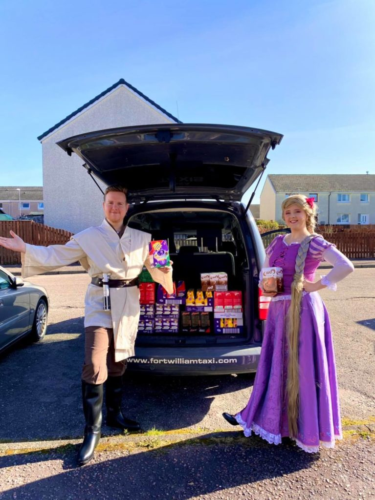 Dressed as their characters from Star Wars and Tangled, Ryan and Hannah get ready to set off with their haul of Easter eggs to give away on Saturday. NO F15 Jedi eggs