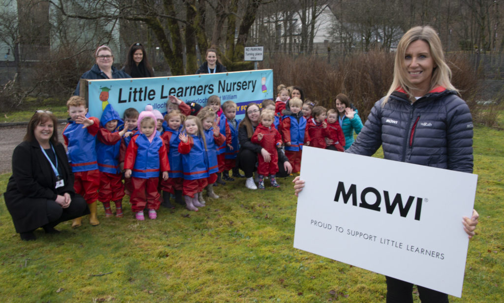 Jayne MacKay of Mowi joined the chidlren and staff of Little Learners Nursery in Inverlochy to find out how they were making use of their new outdoor suits bought with a donation from the company. The suits are worn by the youngsters to give them protection from the Lochaber elements when they go out for walks, or, due to Covid resrictions, spending time in the large outdoor wooded area adjoining the main nursery building. Photograph:- Iain Ferguson, alba.photos NO F15 Little Learners MOWI
