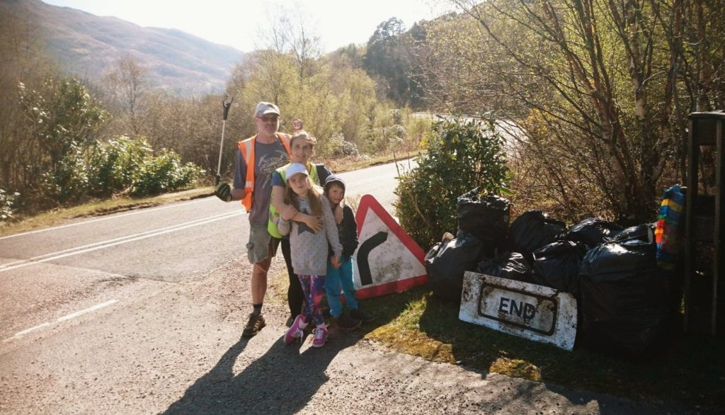 The Burton family and the mountain of rubbish they collected on Sunday close to their Lochailort home. NO F18 Lochailort rubbish 02