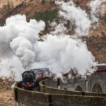 The Jacobite steam train draws tens of thousands of visitors each year to Glenfinnan to see it cross the famous viaduct. Photograph: Iain Ferguson, The Write Image. NO F26 jacobite steam train 01