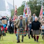 Glenfinnan Highland Gathering field manager Alistair Gibson, second from left, with Chieftain Fergie MacDonald, second from right, lead the opening parade. NO F34 Glenfinnan games-parade