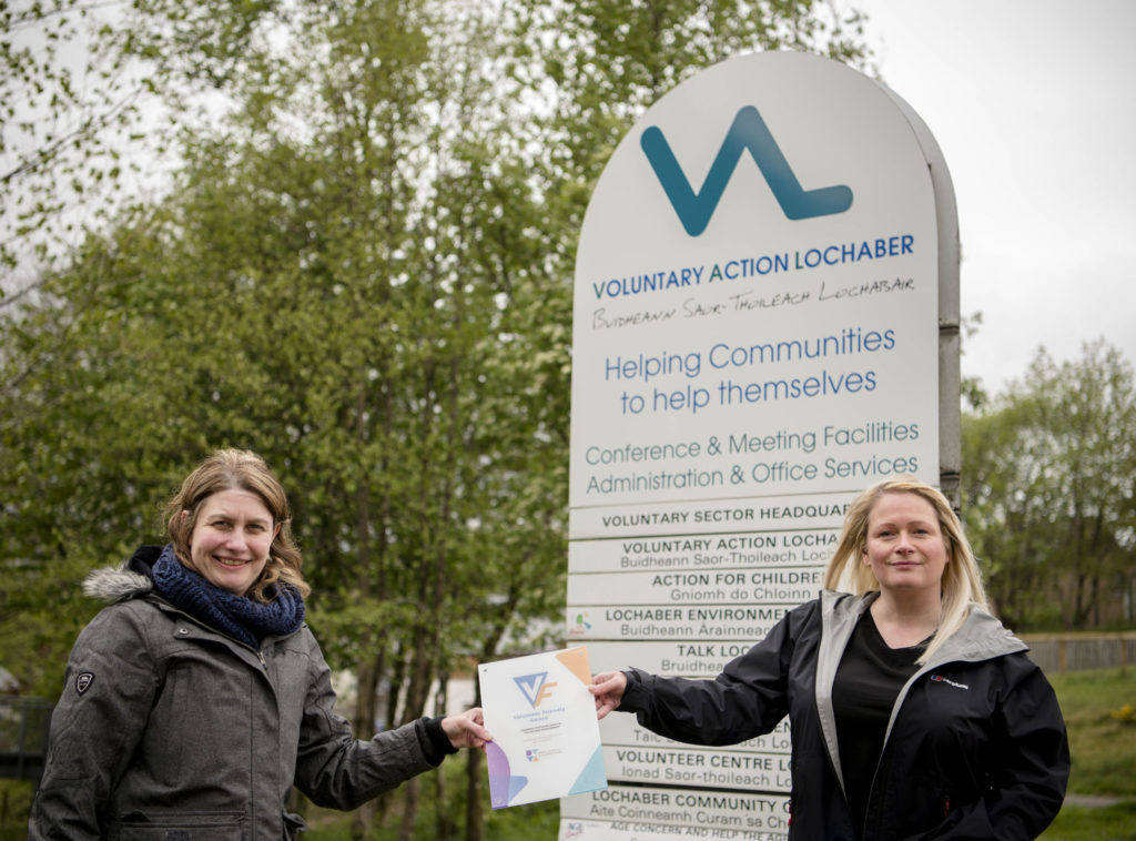 Rachel Tonks, left, and Dani Drummon with the new award. Photograph: Johnpaul Peebles, Abrightside Photography. NO F22 Volunteer Advocacy plaque