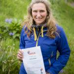 Lochaber volunteer Victoria Kimber with a certificate. Photograph: Johnpaul Peebles, Abrightside Photography. NO-F23-Victoria-Kimber-with-her-certificate_.jpg