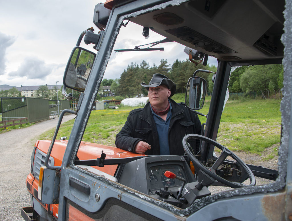Vice-chairman of Fort William FC, Colin 'Woody' Wood with the vandalised tractor which can no longer be used for grass cutting. Photograph: Iain Ferguson, alba.photos NO F24 Claggan 02