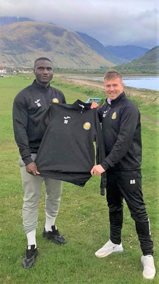Fort manager Ashley Hollyer, right, says he is delighted with new signing Junior Caulker. NO F24 Junior Caulker new