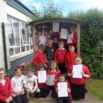 The P4/5 pupils, pictured, set up the Kilchuimen Mini Money Fund to find out more about how a community benefit fund works. NO F25 Kilchuimen Mini Money Fund
