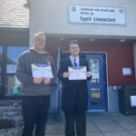 Matthew MacDonald and Ronan MacPhee proudly show off their certificates after completing a four-week Caraidean Uibhist dementia course. No_F22dementia01