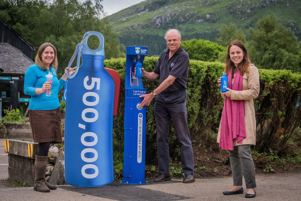 Local MSP Kate Forbes, right, formally launched the new top up tap at Glenfinnan, watched by Emily Bryce, NTS operations manager, and Scottish Water Chief Executive, Douglas Millican. Photograph: Chris Watt/chriswattphotography. NO F29 Glenfinnan tap 01