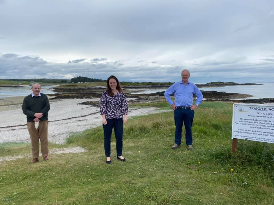 Kate Forbes MSP at Traigh Beach near Arisaig earlier this month, along with local Caol and Mallaig ward councillors, Allan Henderson, right, and Denis Rixson. NO F29 Kate at Traigh Beach
