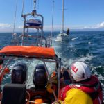 Kyle RNLI lifeboat with the yacht under tow on Monday. Photograph: Kyle RNLI. NO F29 Yacht Under Tow 2