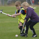 Enthusiastic youngsters try out their skills on the pitch. Photograph: Iain Ferguson, alba.photos NO F30 Street League Shinty 07