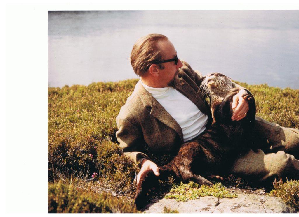 The author Gavin Maxwell and his otter, Teko, relaxing on Eilean Ban. Photograph : Eilean Ban Trust. NO F31 Gavin and Teko on Eilean Ban-1
