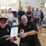 Lord Lieutenant Donald Cameron presents the Queen's Award for Voluntsry Service to Nevis Radio chairman John Weller, who accepted it on behalf of volunteers past and present at the station's AGM in Caol Community Centre. Photograph: Iain Ferguson, alba.photos NO F31 LOCHIEL Nevis Radio award