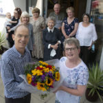 Angus Fyfe presents flowers and a gift to May Dempster, marking her 50 years of working at the Clan MacDuff Hotel. Photograph: Iain Ferguson, alba.photos NO F31 MAY DEMPSTER 50 YEARS
