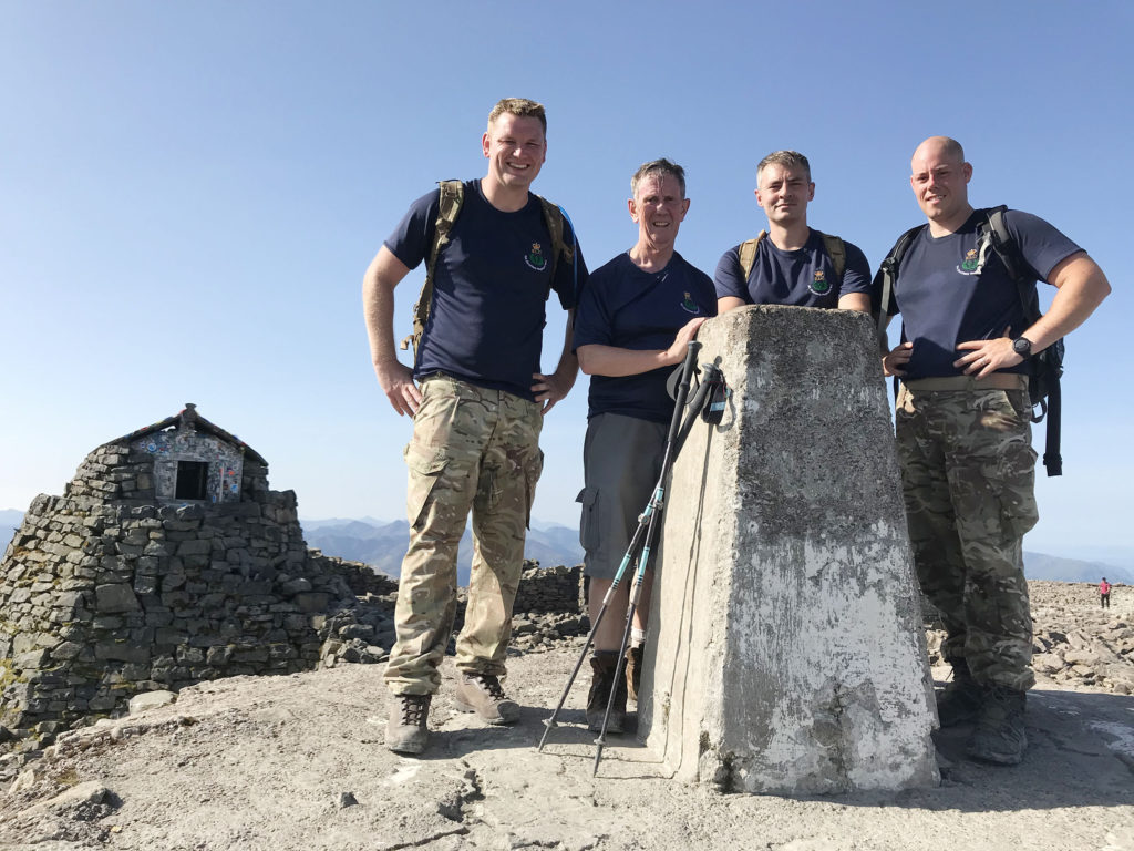 Kilmallie minister Rory MacLeod (second from left) enjoys the weather on the summit of Ben Nevis with the charity team. Photograph supplied. NO-F32-Combat-Stress.jpg