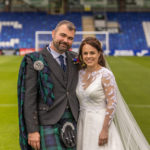 The happy couple, pictured, had photographs taken at at the Global Energy Stadium, home of Ross County FC, a short distance from the church. Photograph: Chris Hoskins Photography. NO F32 Kate and Ali-1001