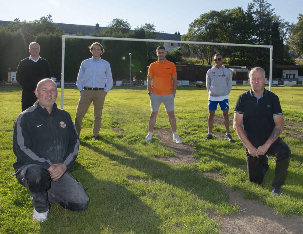 Some of the team which is working to restore Claggan Park, at the ground on Monday night - front from left are Mark Rydings and David MacDonald. Back row from left are Peter Murphy, Olly Stephen, Mark Gillespie and Iain MacKay. Photograph: Iain Ferguson, alba.photos NO F32 Save Claggan Park 02