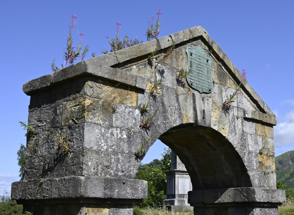 The arch at the Craigs cemetery which once stood as as the entrance way to the old Fort, but now with weeds growing out of its stonework. Photograph: Iain Ferguson, alba.photos NO F32 Weedy arch 02