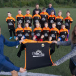 The young players proudly show off their new strips with Michael Gillespie and Lisa MacGillivray. Photograph: Iain Ferguson, alba.photos NO F35 FORT U12 NEW TOPS