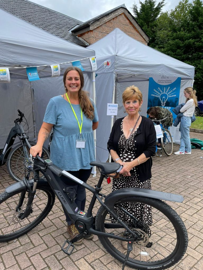 Left, Lucy Cooke – Development Officer at the Kinlochleven Community - with Maureen Fyfe- the bikes are named in her husband's memory. NO F35 Lucy and Maureen