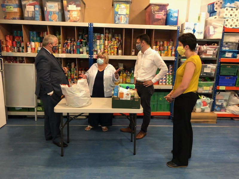 Ross, Skye and Lochaber MP Ian Blackford, left, visited the food bank in Glasgow with fellow politicians on Thursday. NO F36 Blackford - Food Bank visit