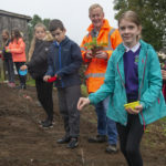 Primary 7 pupils of Lundavra school help plant seeds as part of the Upper Achintore Regeneration Group 'Greening the Burn' project. Photograph: Iain Ferguson, alba.photos NO F37 Greening the burn 01