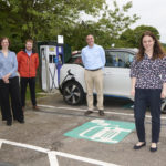 Kate Forbes, MSP. Skye, Lochaber and Badenoch right) is pictured at a rapid charge point with (left to right) Gemma Robinson, FASTER Project Manager, HITRANS, Lewis Hunter, Research and Development Engineer, University of Strathclyde and Ranald Robertson, Director, HITRANS. NO-F38-EV-Project-with-KF.jpg