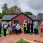 From left, Gavin Brown, Contracts Manager for Compass Building and Construction Services; Shirley MacDonald, Housing Development Assistant; Anna Wasko, Housing Management Officer; Julie Vivers, Housing Manager; Harry Whiteside, Chair of the Fort Augustus and Glenmoriston Community Company; Claire Cameron NHS Highland Programme Manager; Kerry Watson, Telford Centre Care Home Manager; Emma Micklethwaite, Housing Development Officer; Karen-Anne Wilson, NHS District Manager for Lochaber and Councillor Margaret Davidson. Photograph: Michael Jack, architect with Bracewell Stirling. NO F40 Fort Augustus housing project