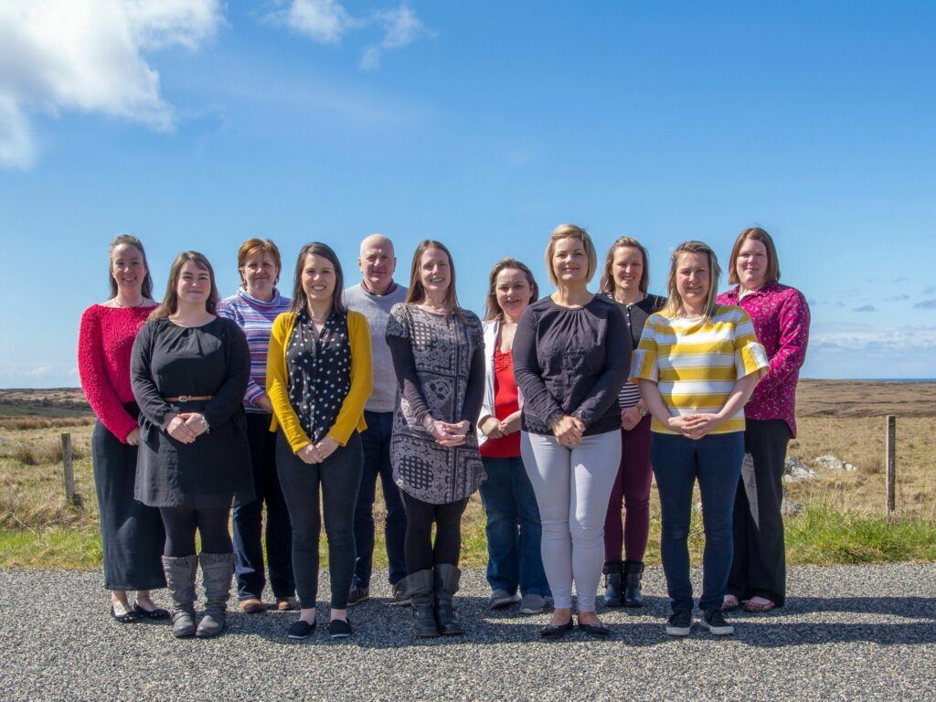 Lisa, fourth from right, with UOG staff in 2019. NO F40 Lisa with Staff in 2019